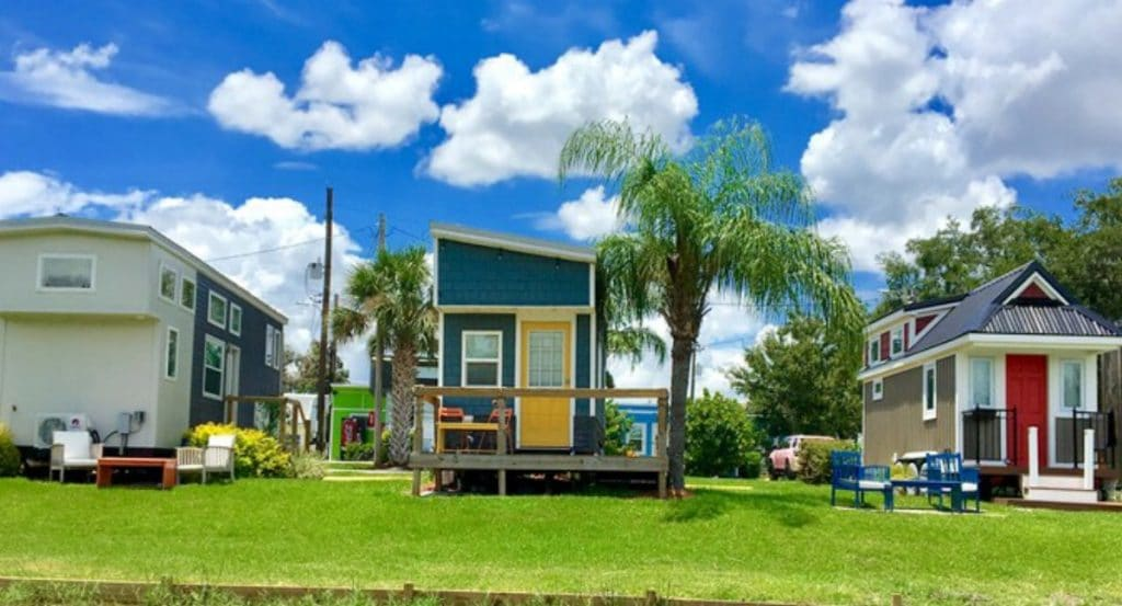 Teal tiny house on grass