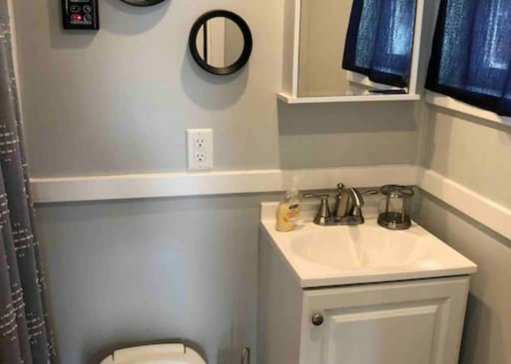 Small bathroom with white walls