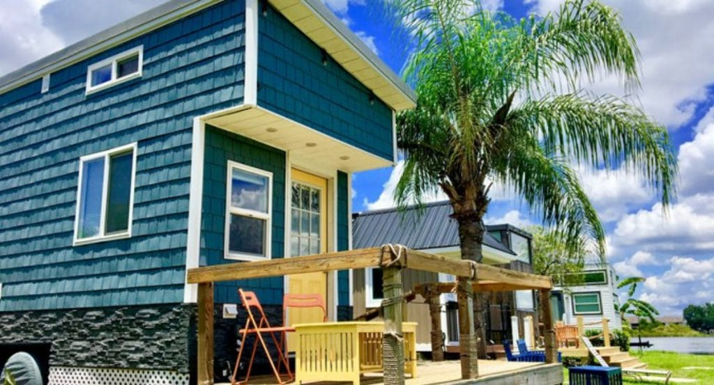 Front of teal tiny house with porch