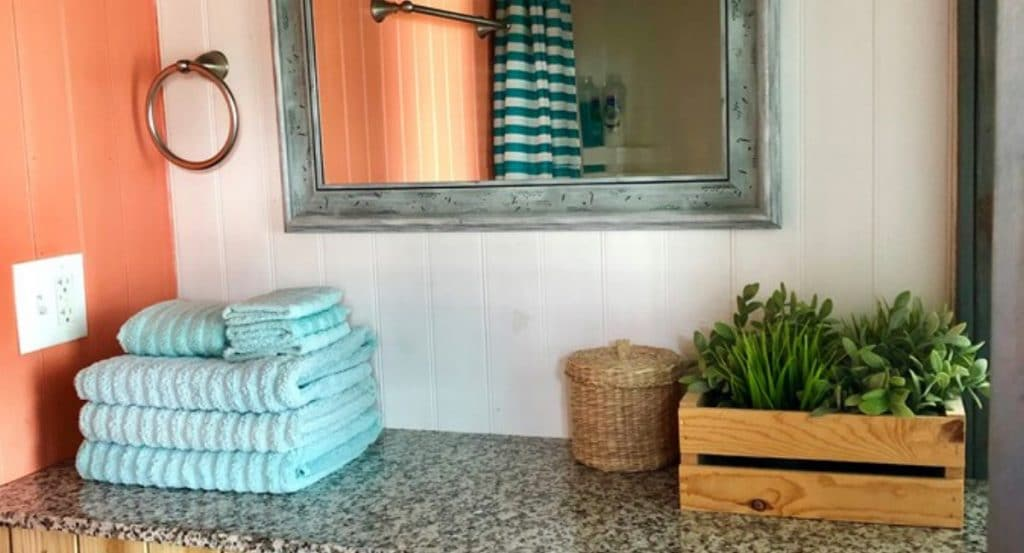 Bathroom counter with teal towels