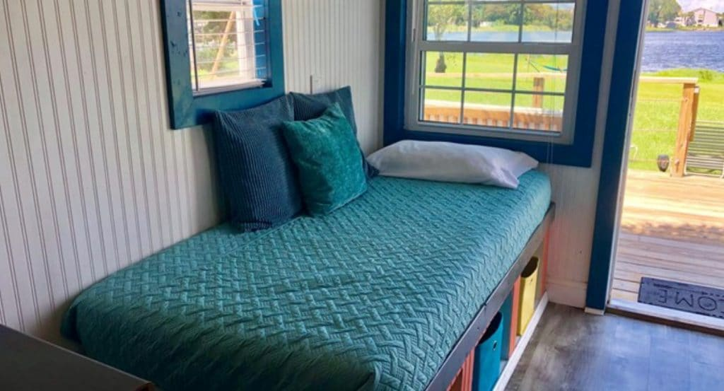 Teal blanket on storage bench bed