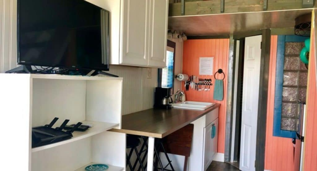 Tiny home kitchen with coral wall