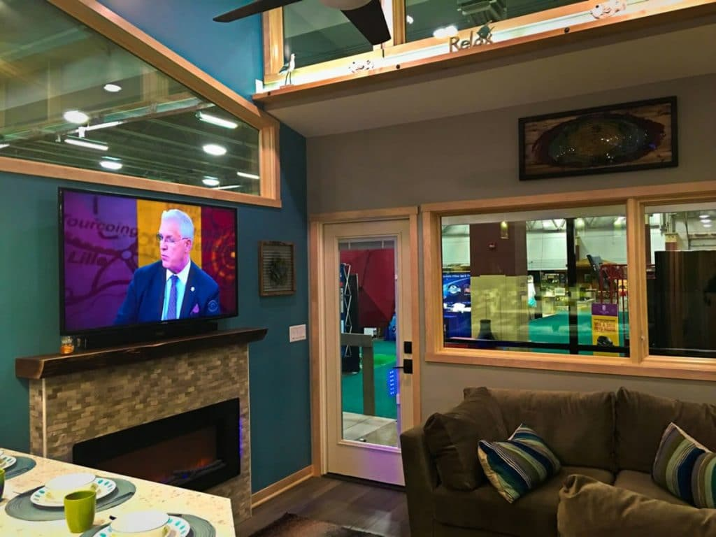 Living area in tiny home with tv