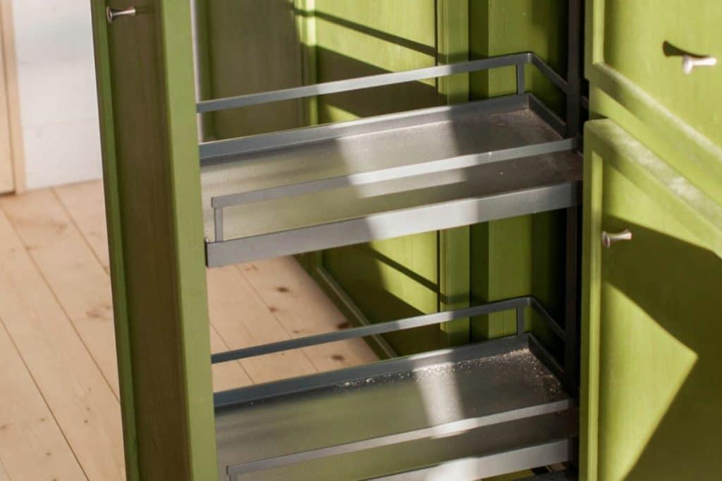 Green hidden cabinet in kitchen