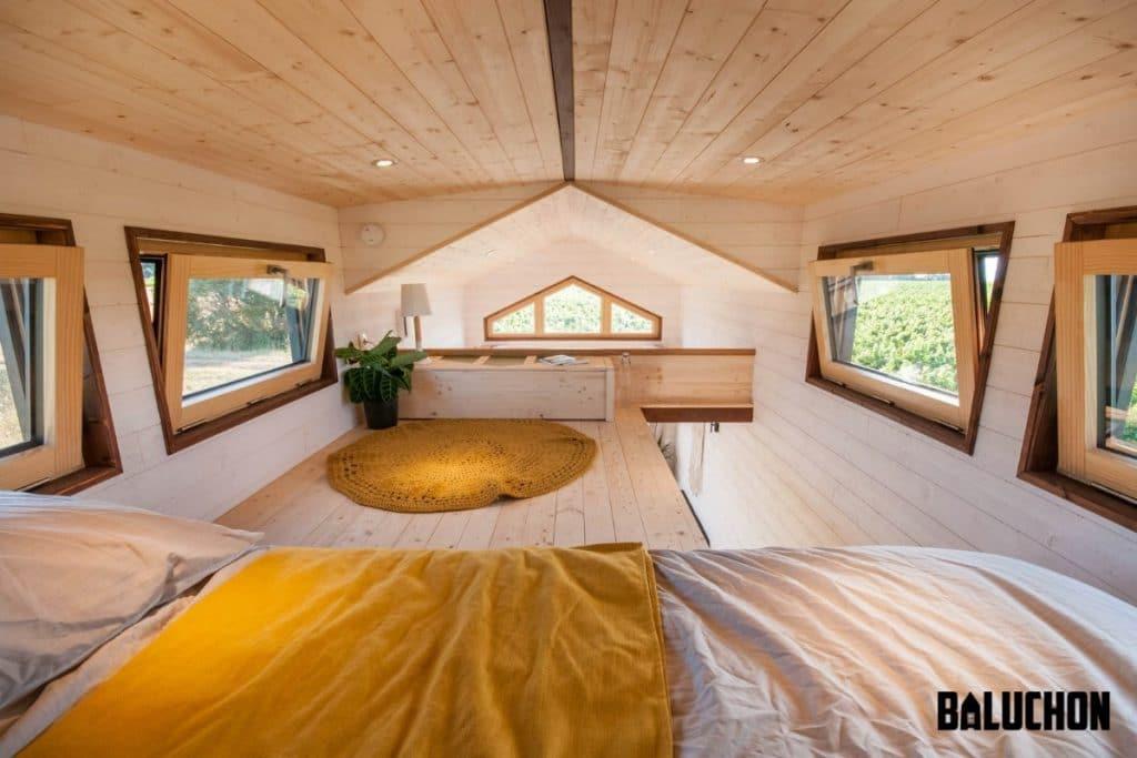 Loft bedroom landing with yellow rug