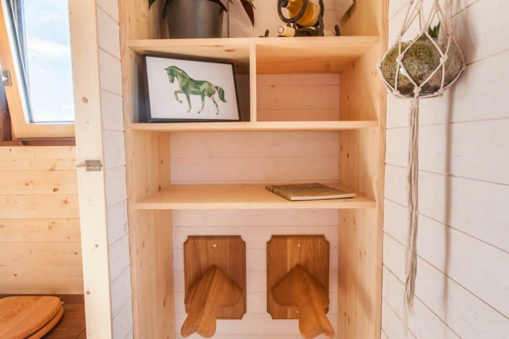 Bathrom with wood cabinet and towel racks