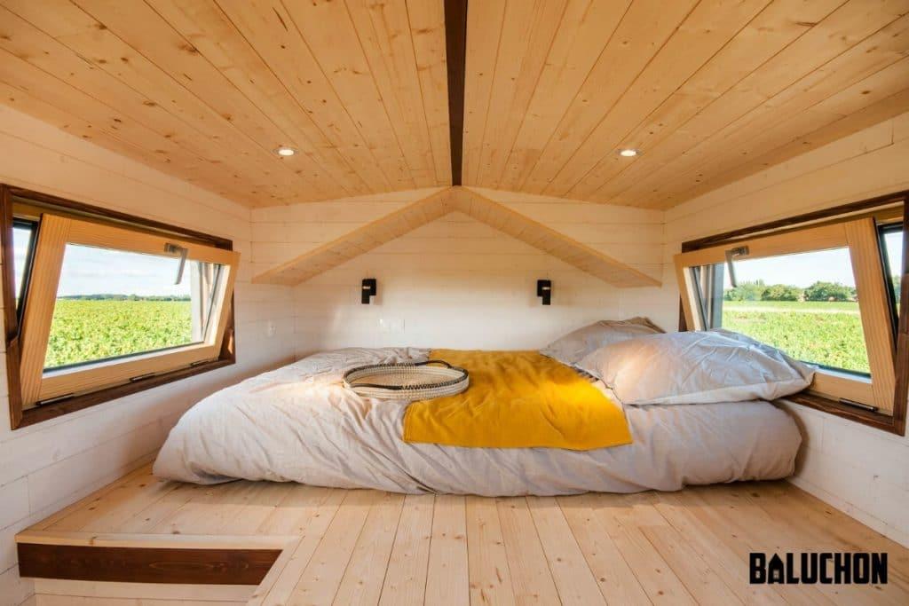 Loft bed with yellow balnket