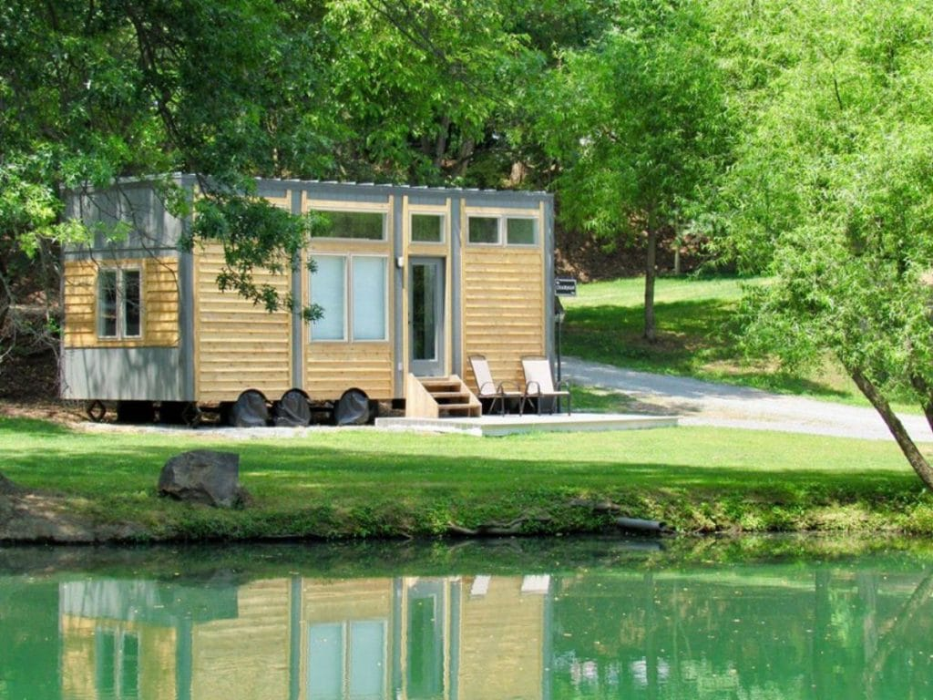 The Chairman tiny house by pond