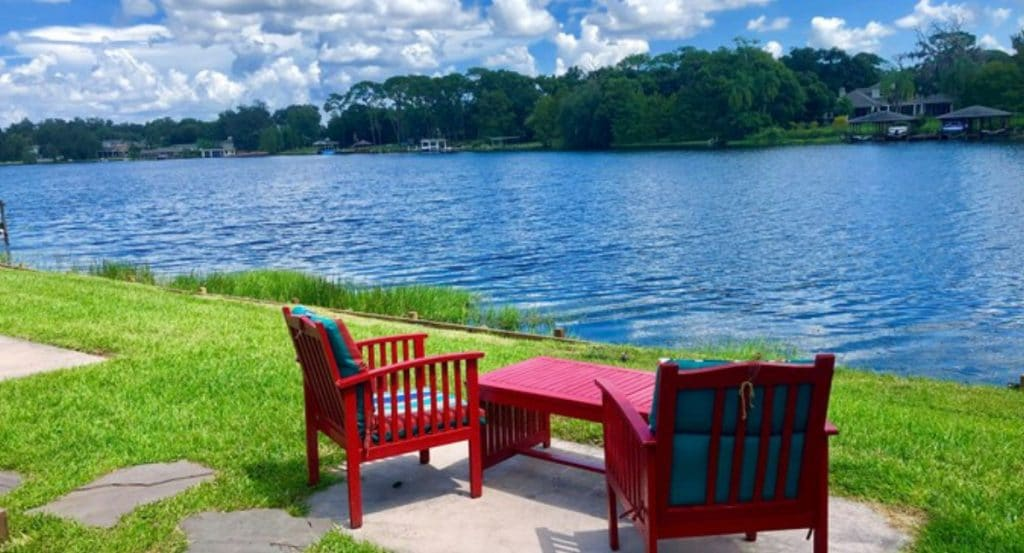 Red deck chairs by lake