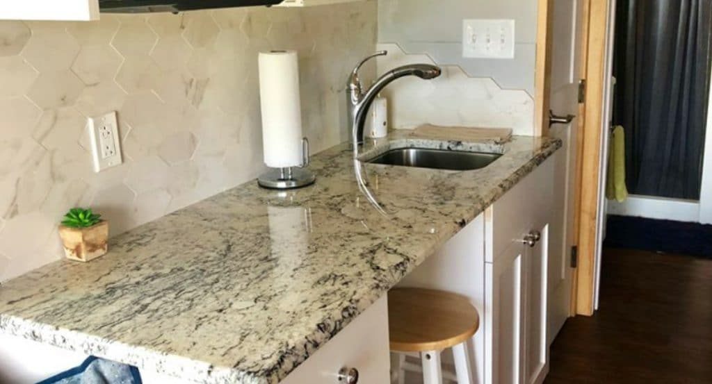 Marble counter with sink and undercounter stool