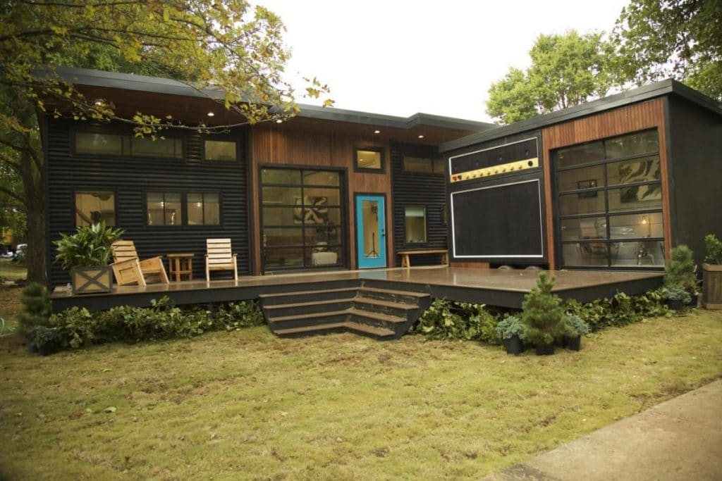 Dark wood tiny home with garage doors