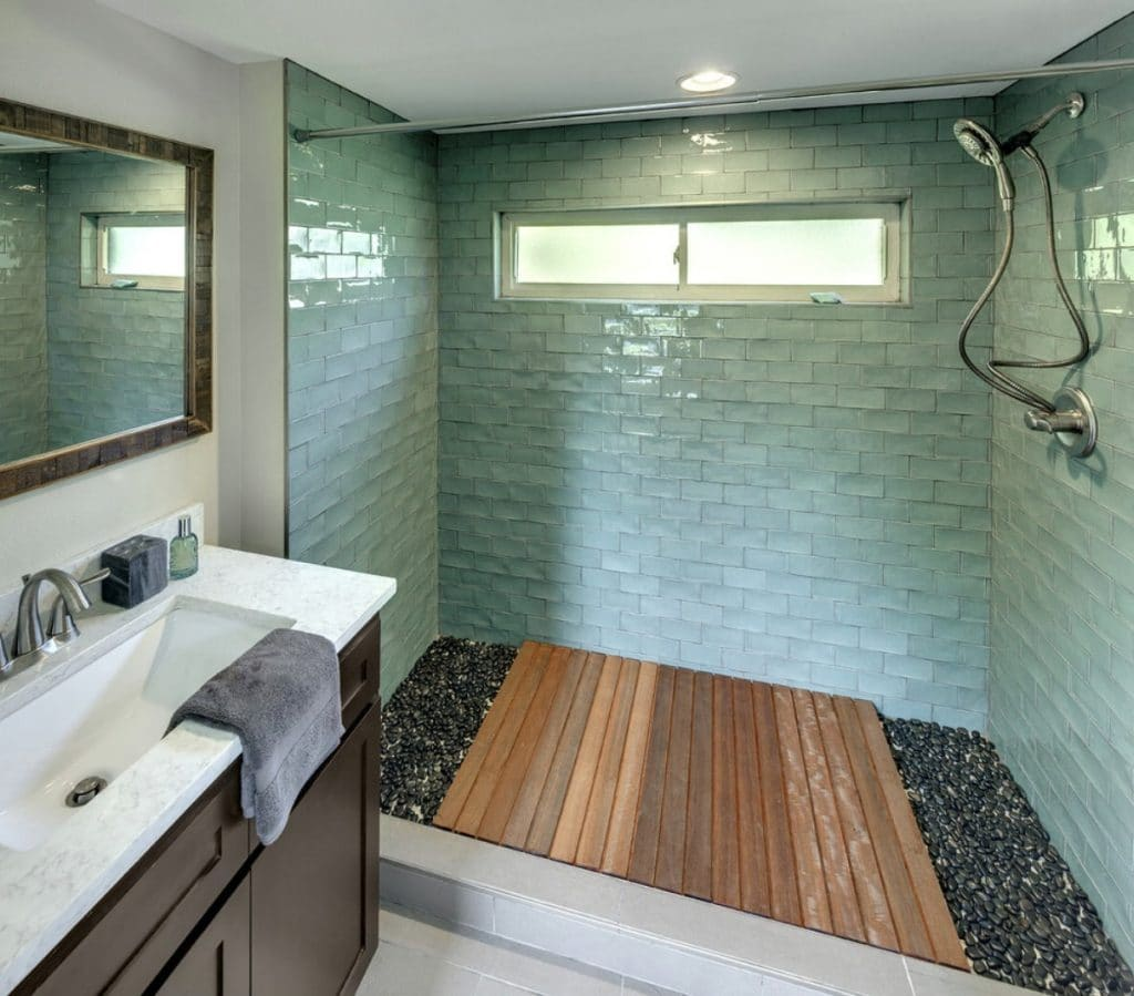 Spa shower withg reen tile