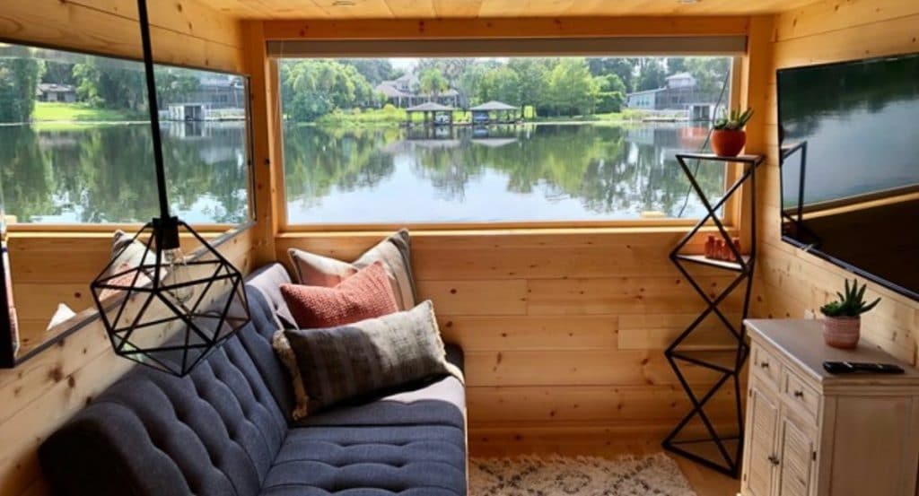 Sofa by window in tiny home