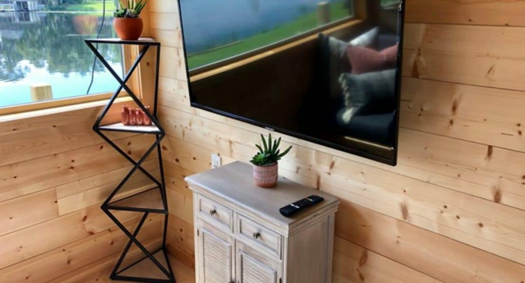 Table under TV in tiny home