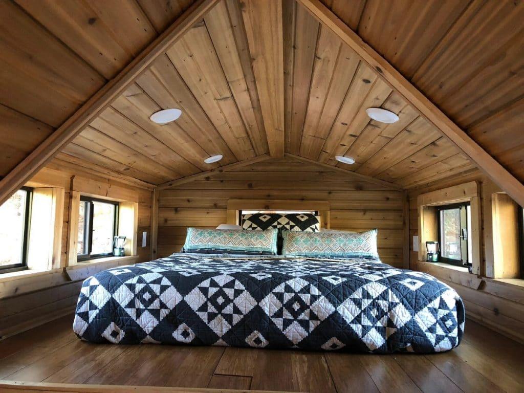 Loft bedroom with blue blanket