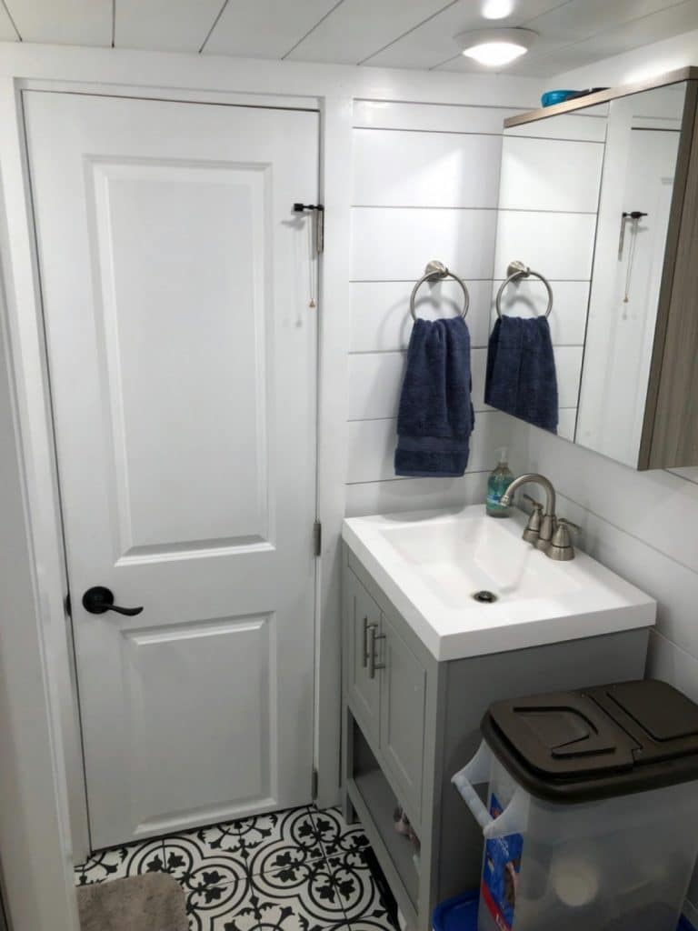 Toilet in tiny house with shiplap walls
