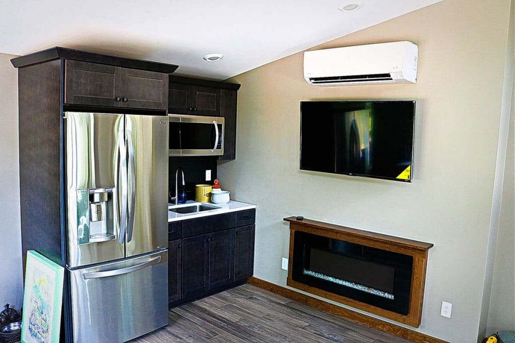 Refrigerator and fireplace in kitchen