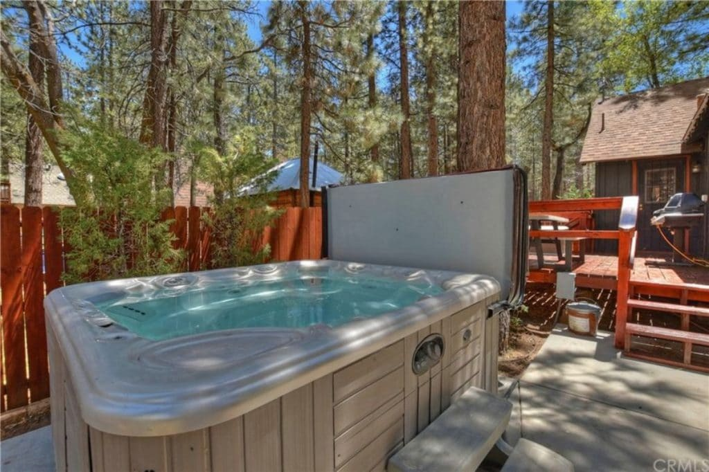 Hot tub behind cabin