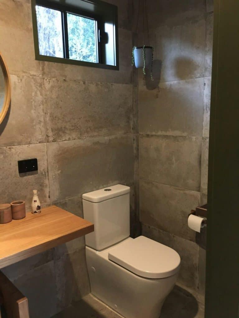 Bathroom with concrete walls