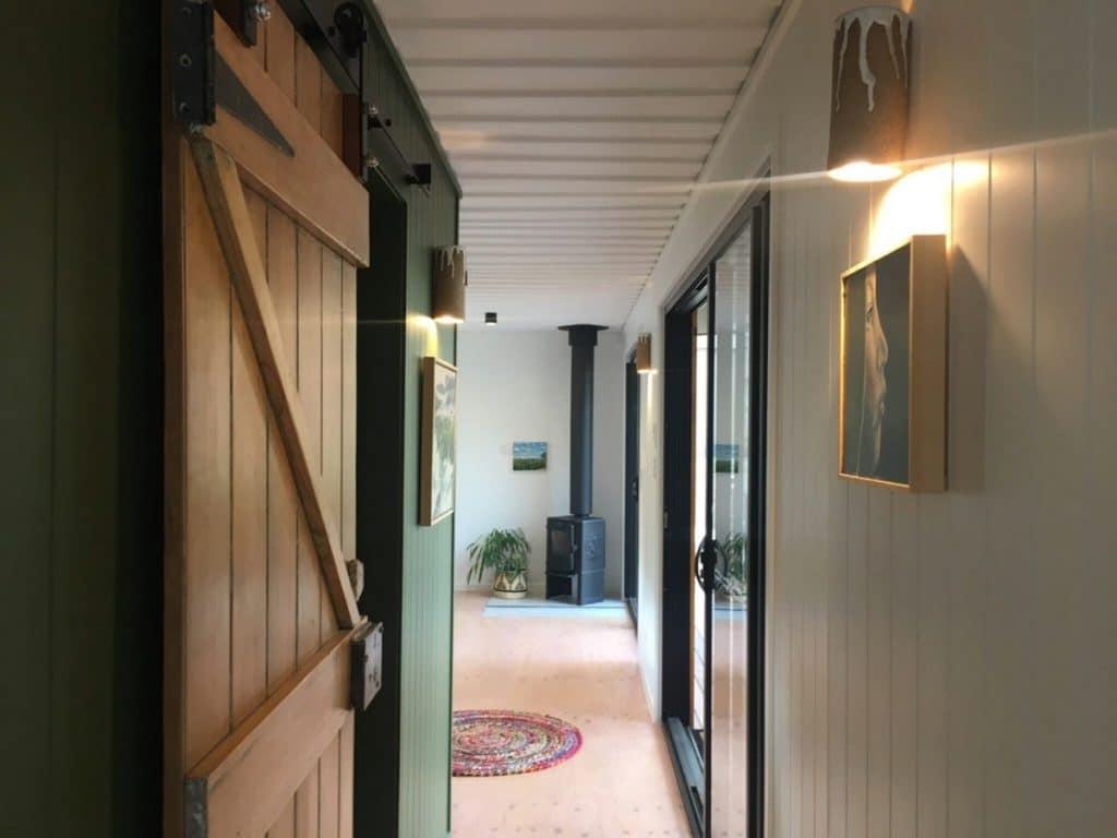 Barn door to tiny bathroom