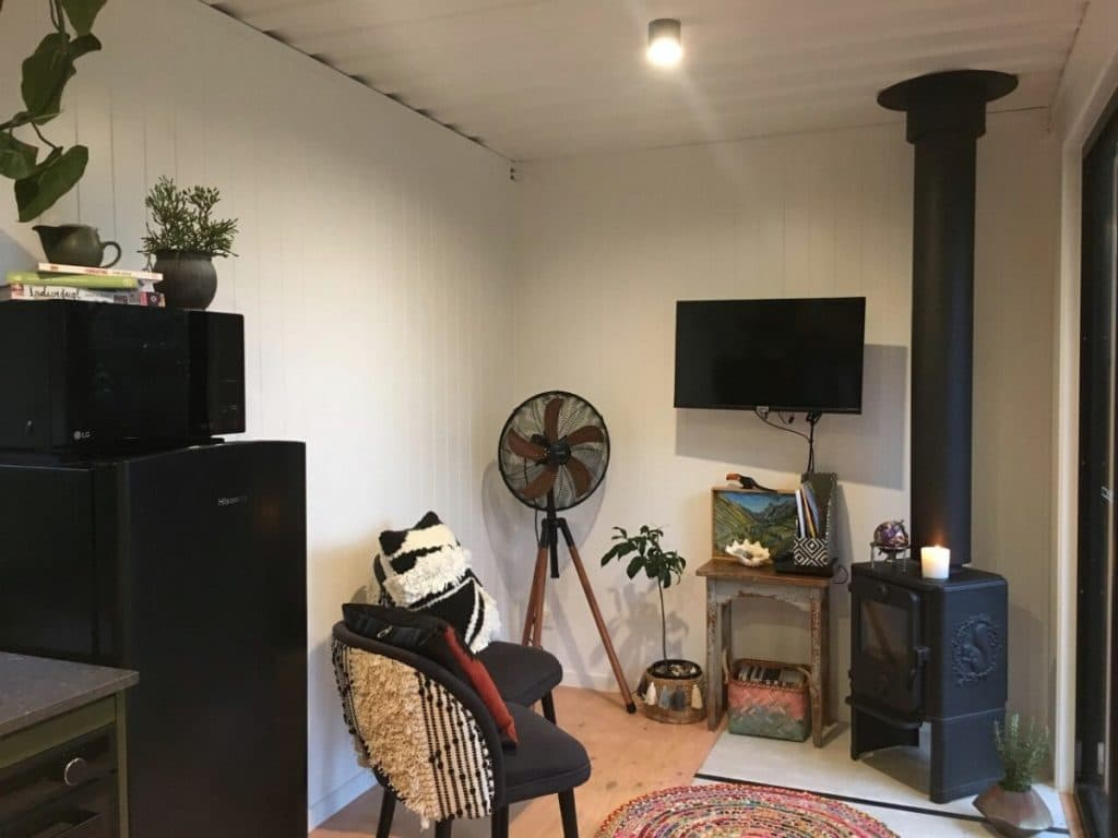 Tiny house living room with fireplace
