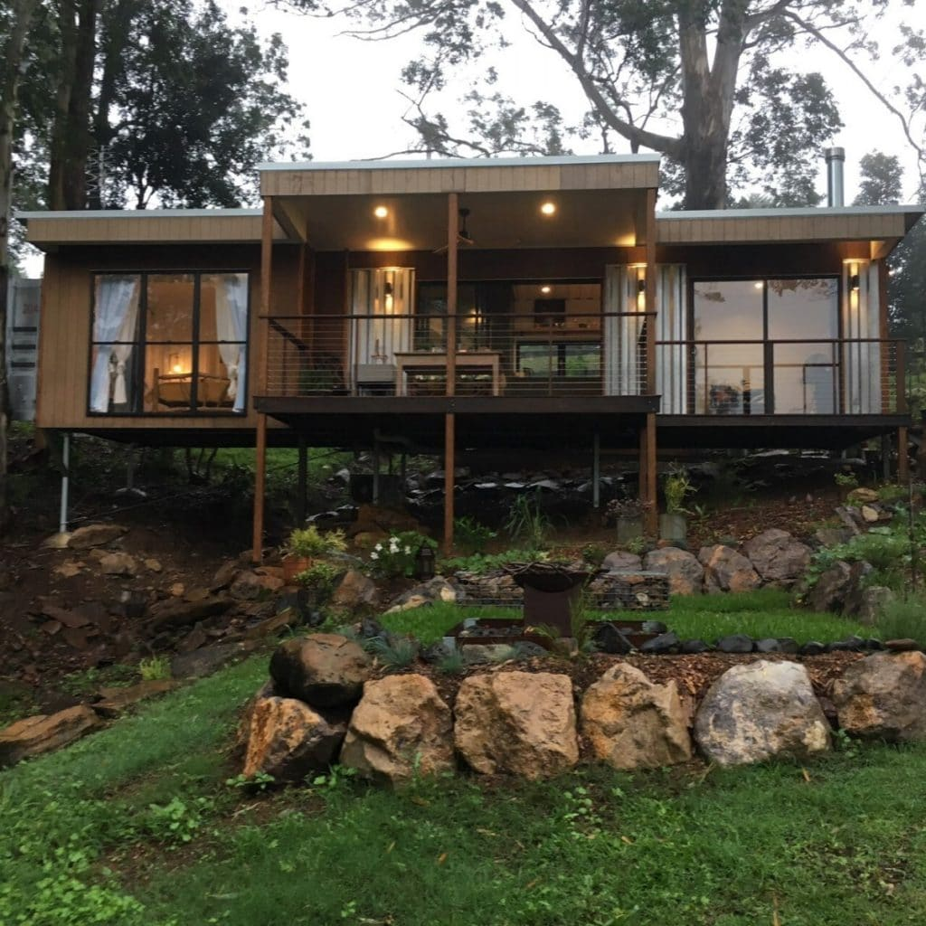 Converted container tiny house with porch