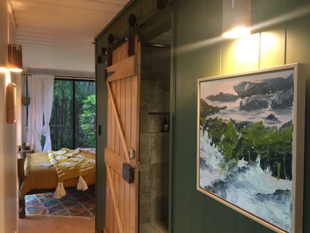 Sliding wood barn door against green wall