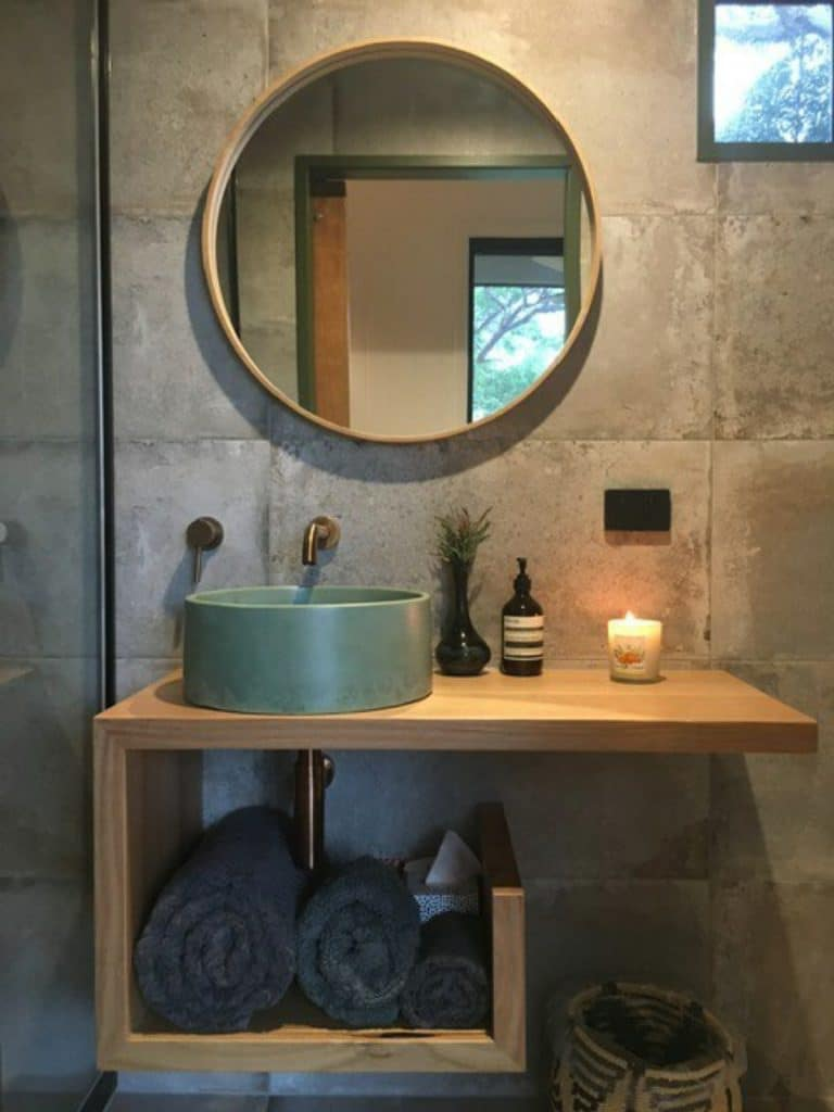 Vanity with round mirror and bowl sink