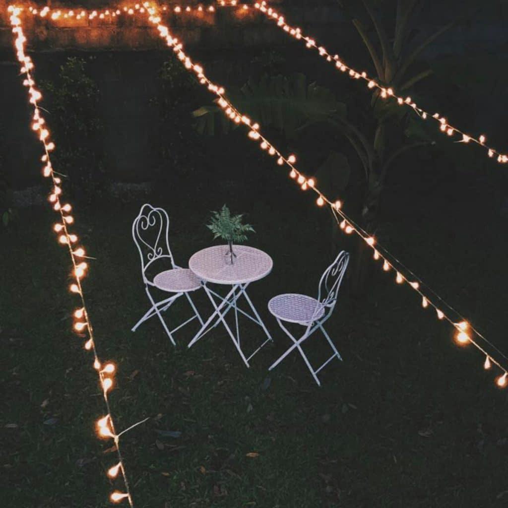 Lawn furniture under twinkle lights