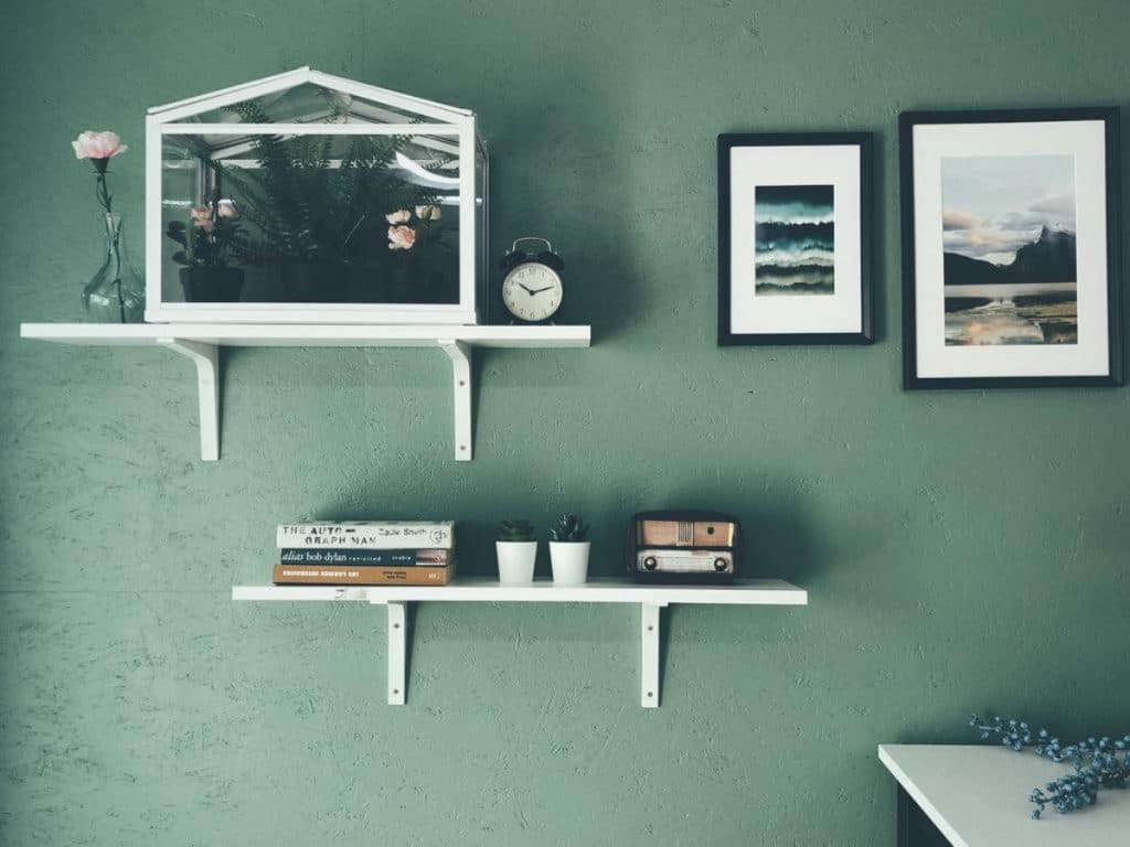 Shelf on green wall