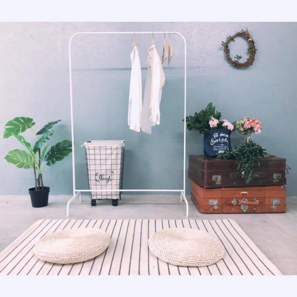 Clothing rack against blue wall