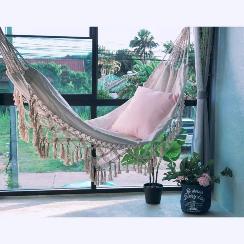 Hammock in front of windows