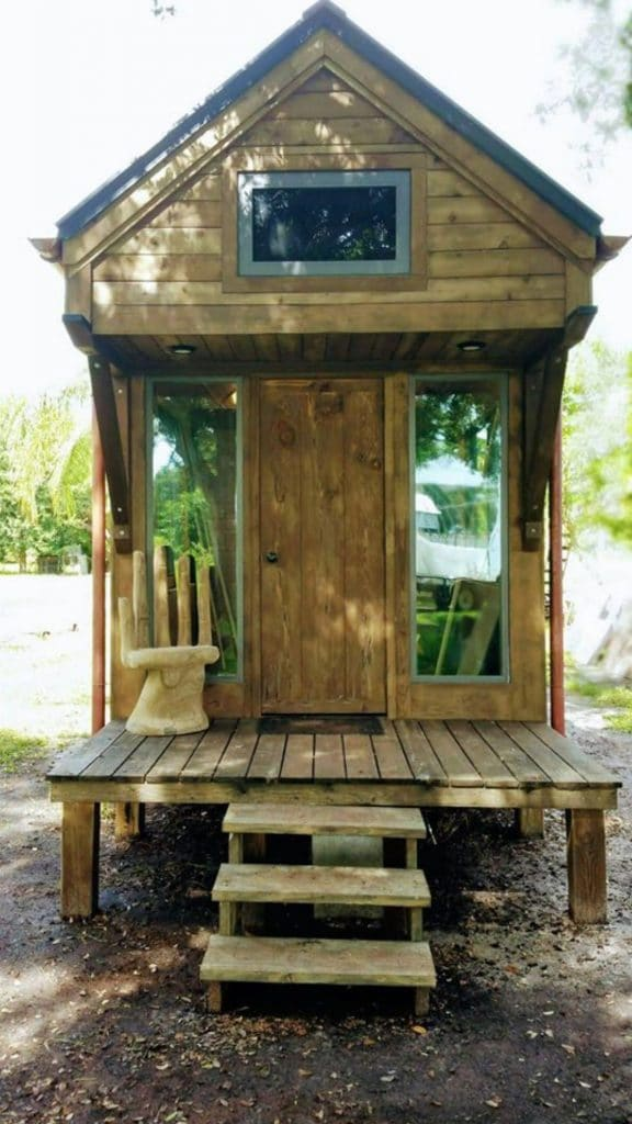 Front porch of woodwork tiny house