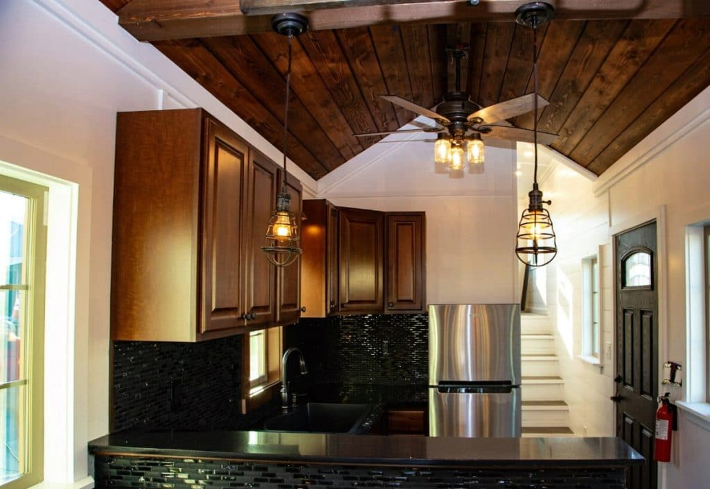 Dark countertops in kitchen with dark wood trim