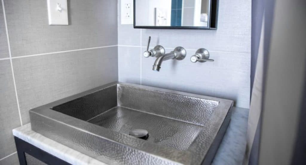 Stainless steel sink in the Swan tiny home