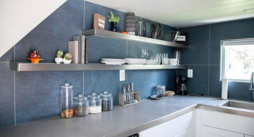 Floating shelves in tiny home kitchen
