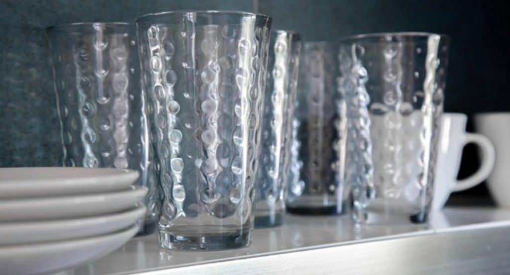 Glasses and plates on shelf in the swan