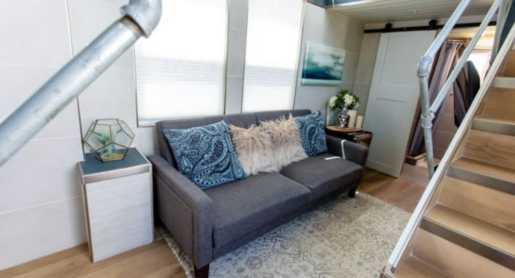 Gray pull out couch in the Swan tiny house