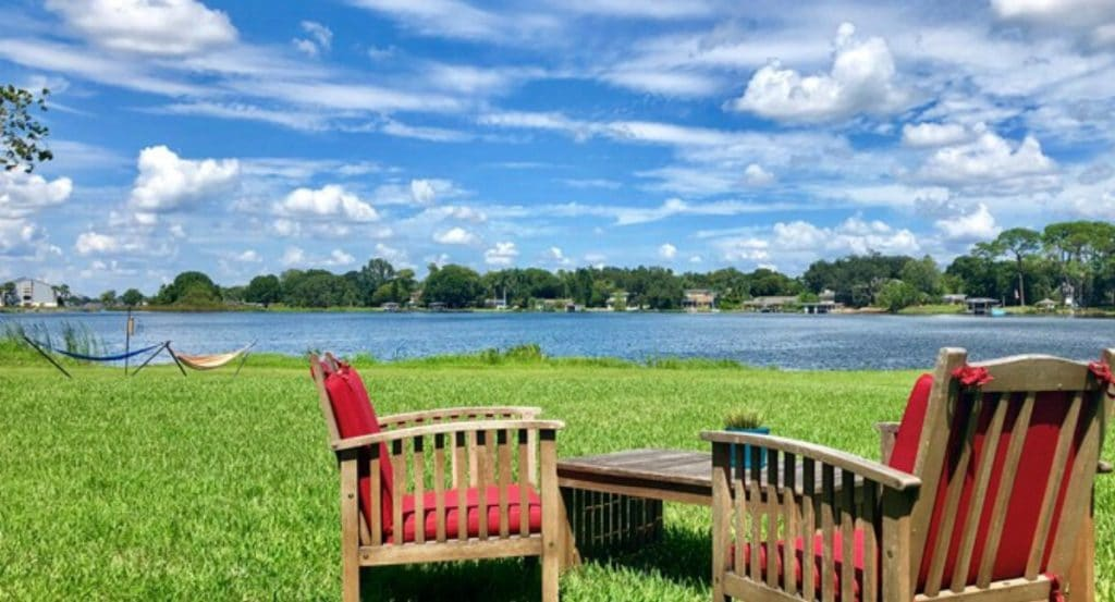 Red lawn chairs by lake