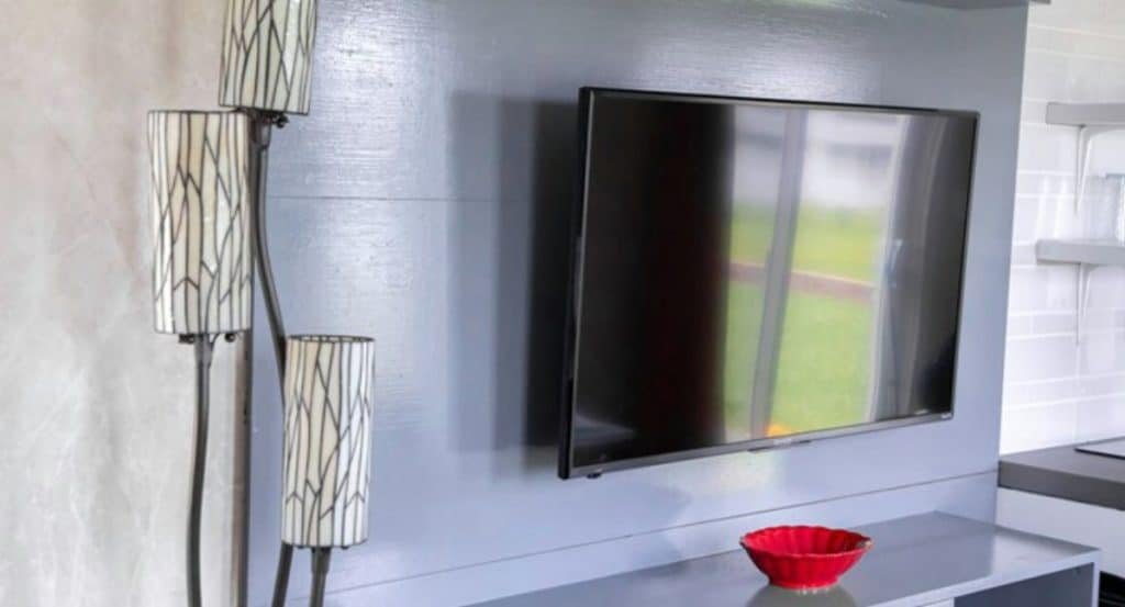 Flatscreen TV on wall of living space