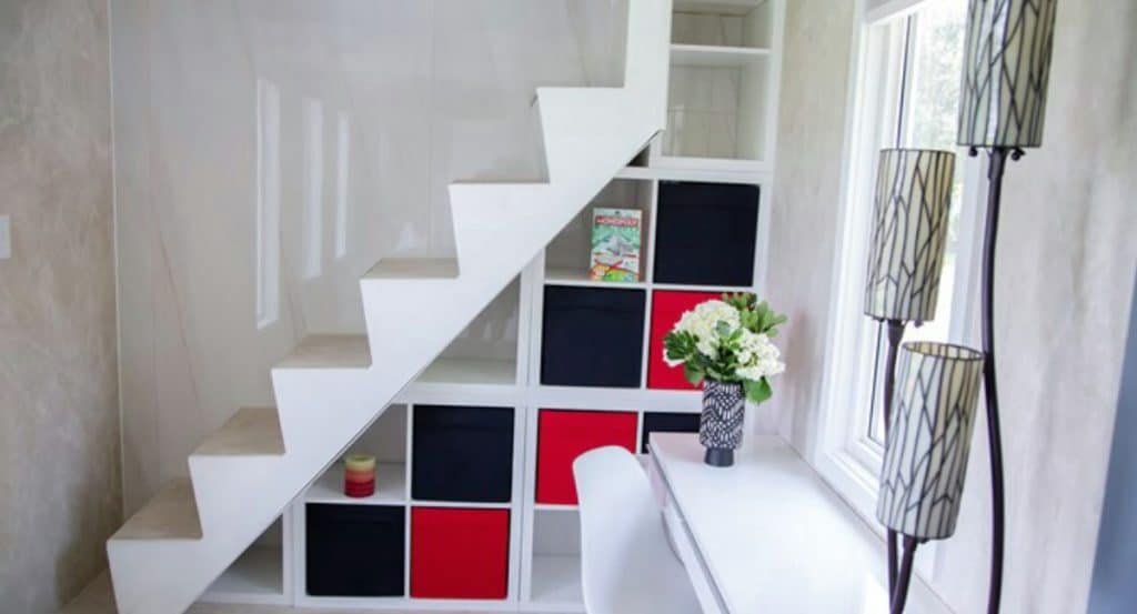 Red and black storage staircase in tiny home