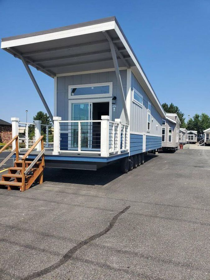 Blue two toned tiny house with porch