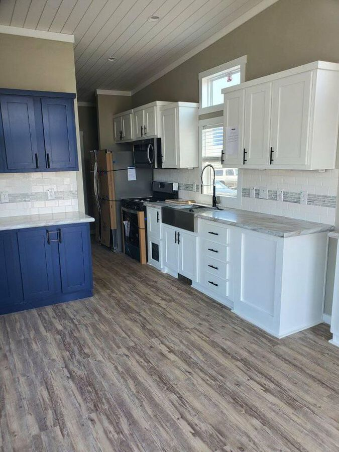 Blue park model tiny house kitchen
