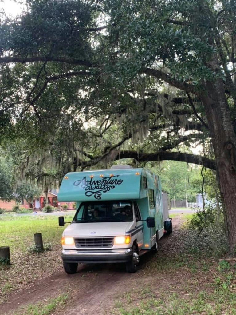 RV parked under tree