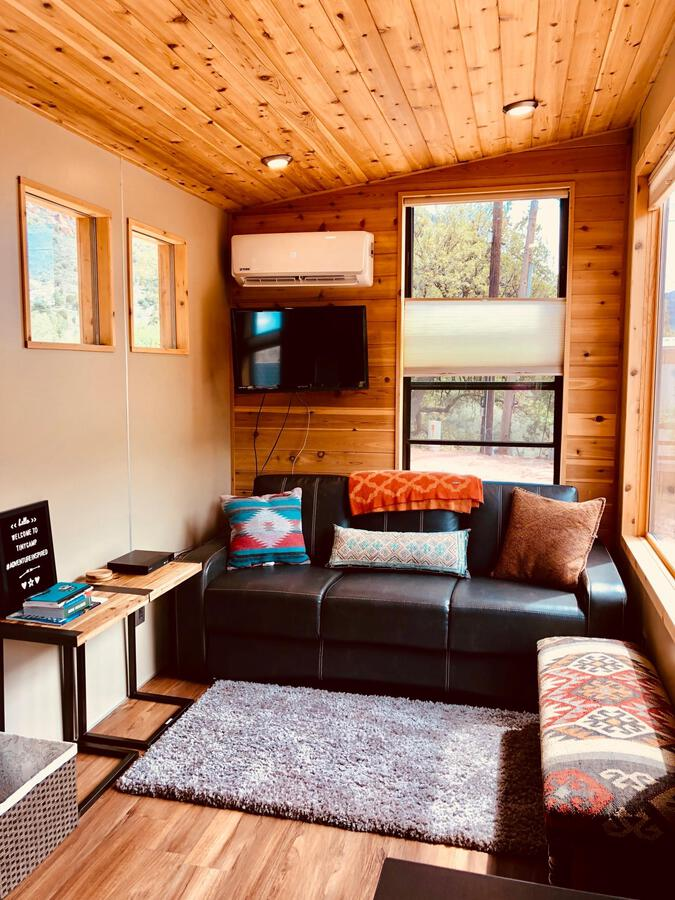 Sofa in corner of tiny house living area