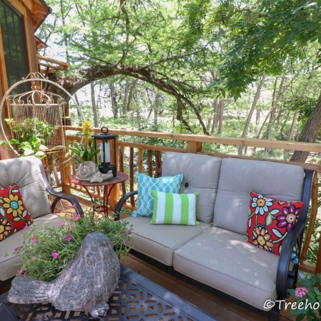 Cream outdoor sofa in treehouse