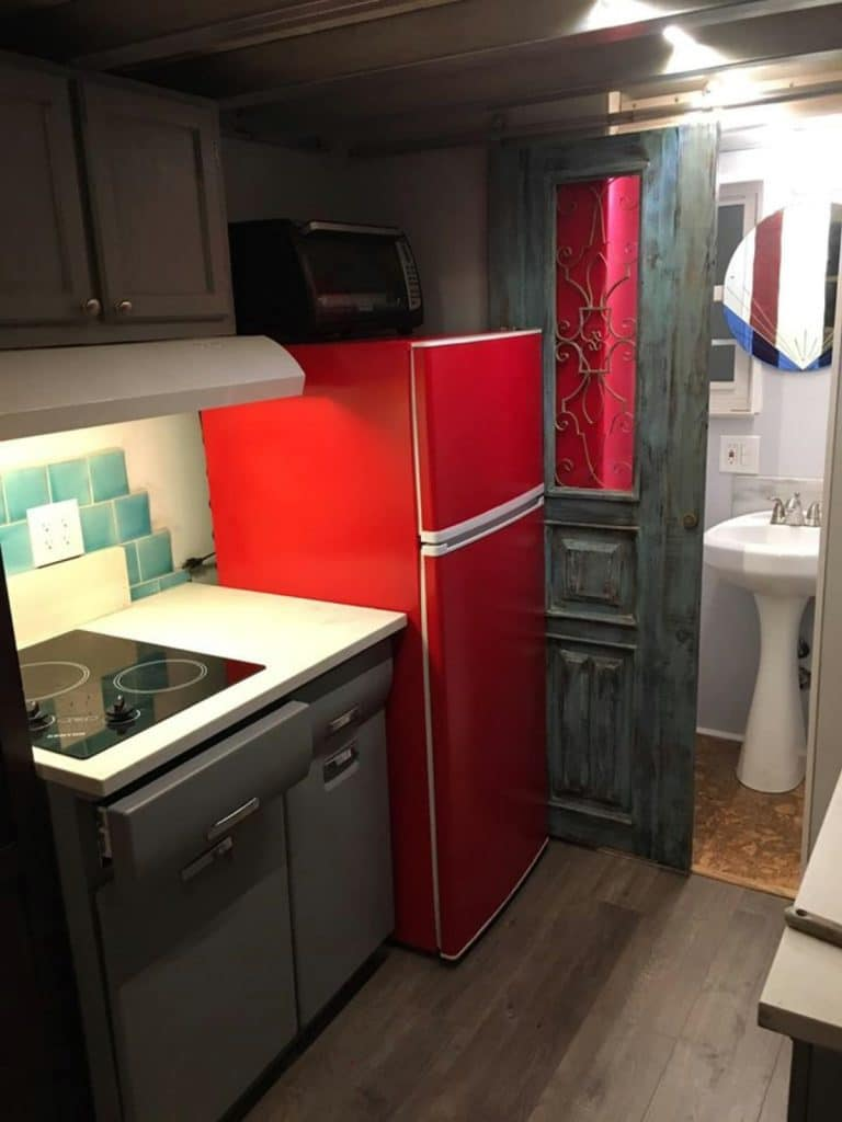 Red refrigerator in tiny house