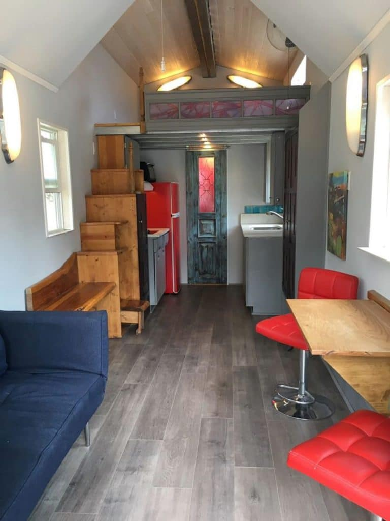 Tiny house living space with red chairs