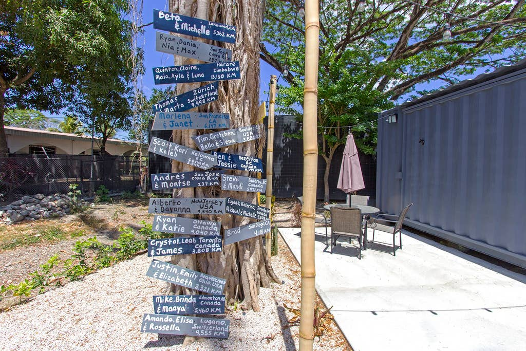 Location signs on tree by tiny house