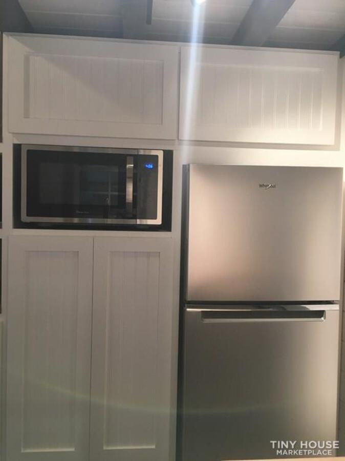 Stainless steel refrigerator with white cabinets